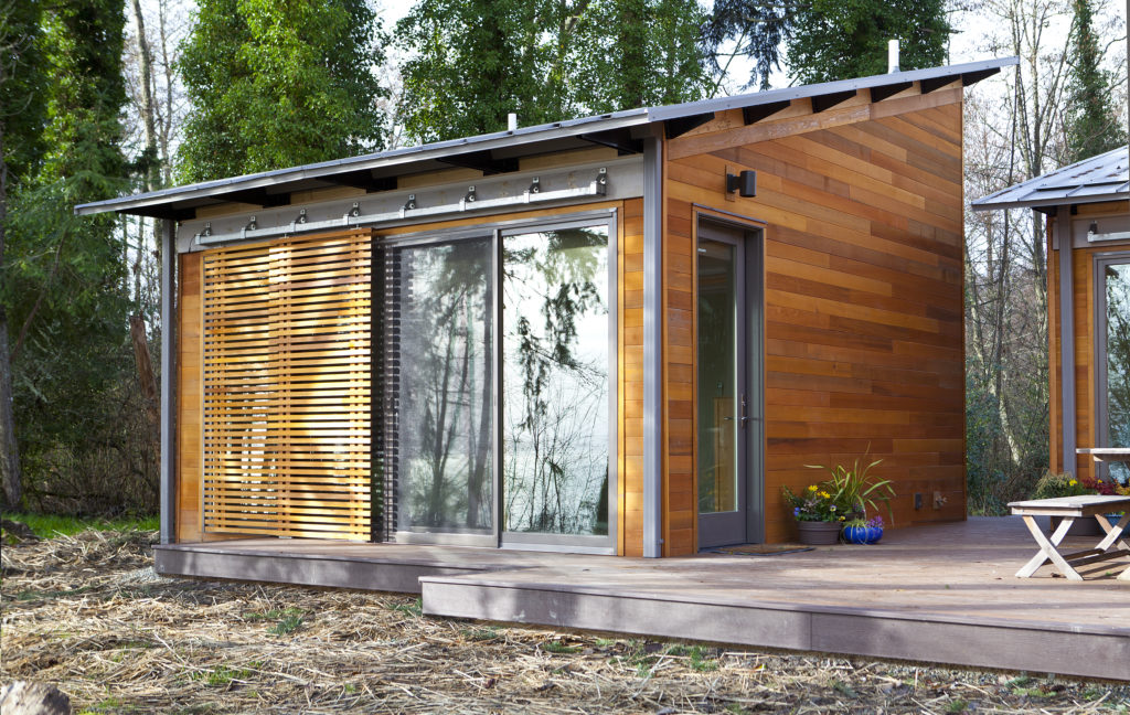 sliding box track screens on tiny modular house
